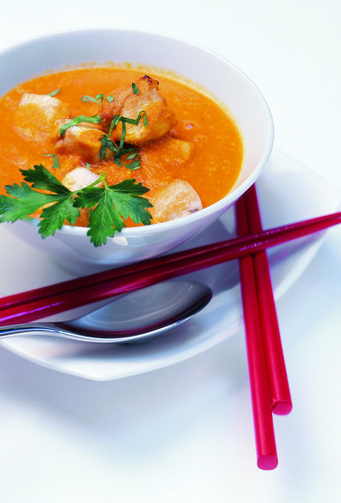 Poulet au curry et aux tomates